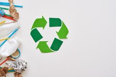 Protect the environment. Crumple foil, paper and plastic royalty free stock image