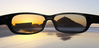 Protect eyes from the sun on the beach. Royalty Free Stock Photo
