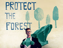 Protect the Forest Ecological Issue Concept. Businessman Promoting Saving the Forest Concept Royalty Free Stock Photo