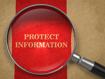 Protect Information - Magnifying Glass. Royalty Free Stock Photos