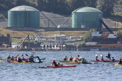 Protect the Inlet Flotilla and water ceremony. Protesters in a flotilla of kayaks and canoes cross the Burrard inlet to gather near Kinder Morgan`s Westridge stock photos