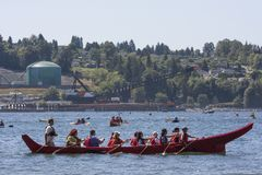Protect the Inlet Flotilla and water ceremony. Protesters in a flotilla of kayaks and canoes cross the Burrard inlet to gather near Kinder Morgan`s Westridge stock photo
