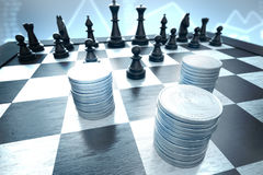 Protect investment against black chess pieces on a blue infograp. Money stacks attacked by black chess pieces on a blue stocks background Stock Photos