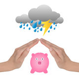 Protect money. Female hands protecting a piggy bank from storm. Protect money, saving and investments concept Stock Photo