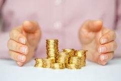 Protect new business start-up concept with hands and coin. Protect new business start-up concept - with hands and coin Royalty Free Stock Image
