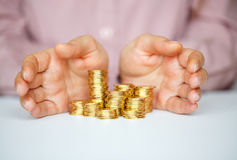 Protect new business start-up  - with hands and coin Royalty Free Stock Photo