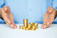 Protect new business start-up  - with hands and coin Stock Images