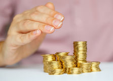 Protect new business start-up with hands and coin Stock Photo