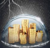 Protect savings. Concept of insurance and money protection. 3D Rendering. Coins safely inside a sphere during a storm. 3D Rendering royalty free stock image