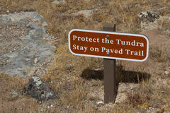 Protect the Tundra Stay on Paved Train warning sign. In Rocky Mountan national Park Royalty Free Stock Photography