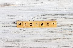 Free PROTECT Word On Block Concept. PROTECT Word Made With Wooden Blocks On The Table Stock Images - 100121314