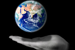 Protect the world. A hand protecting the world from falling Royalty Free Stock Images