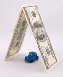 Protect your car. Toy retro car protected by money Royalty Free Stock Photos
