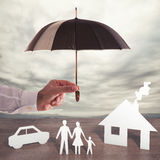 Protect your family. Paper family covered by an umbrella. Protect your family concept royalty free stock photo