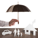 Protect your family. Paper family covered by an umbrella. Protect your family concept royalty free stock photos