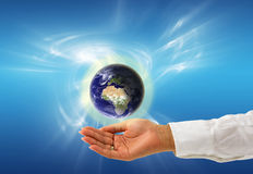 Protect your globe. Female hand protecting earth planet illustration with abstract background Stock Photo