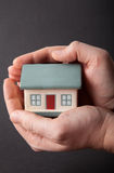 Protect your home. A house held in two hands Stock Photography