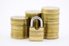 Protect Your money. Padlock with coins isolated on white Stock Images