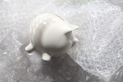 Protect your saving. Piggy bank protect by using bubble wrap Stock Photography