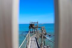 Ancient fishing machine called ` trabucco `. Typical of the Italian Adriatic sea. Used in Abruzzo, Molise and Gargano coast. stock photos