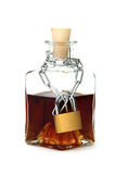 Protected bottle of whiskey Royalty Free Stock Photography