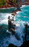 Waves crashing over a rocky outcropping Royalty Free Stock Images
