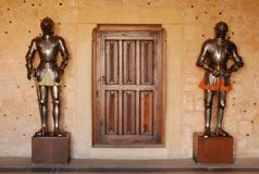 Protected door. 2 armoured standing at the closed door royalty free stock image