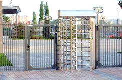 Protected entrance gate.Entrance to office through big in full human growth stainless steel turnstiles. Concept of security, lock stock photo