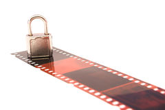 Protected film. Film and padlock captured over white Stock Photography