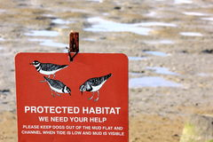 Protected Habitat warning sign. To keep dogs out in wetlands royalty free stock images