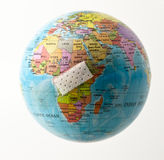 Protecting Africa. Wound Plaster over African continent Royalty Free Stock Image