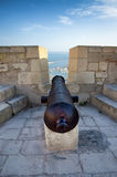 Protecting cannon on the top of Alicante castle Santa Barbara, Spain Stock Photography