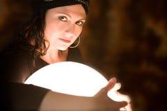 Protecting the crystal ball Stock Image