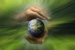 Protecting Earth. Hands holding and protecting planet earth, green environment concept Royalty Free Stock Photo