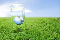 Protecting earth inside a crystal jar Royalty Free Stock Photos