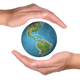 Protecting the Earth planet Stock Images