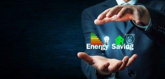Protecting Energy Saving concept. Businessman protecting Energy Saving concept stock photography