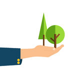 Protecting environment. Flat style illustration of trees in hand isolated on white background Stock Photo