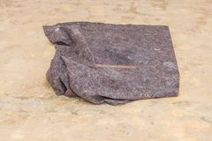 Protecting fleece used for renovation works. A piece of protecting fleece used as a cleaning rag Royalty Free Stock Photo