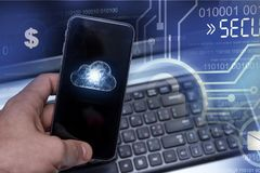 Hacking mobile devices by hackers. Data protection in the cloud royalty free stock image