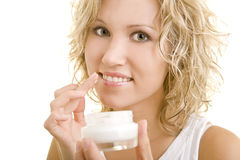 Protecting the lips. Blonde woman applying lotion to her lips stock photos