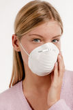 Protecting mask. Young woman with protecting mask Royalty Free Stock Photography