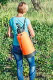 Protecting potatoes plants from fungal disease or vermin with pressure sprayer royalty free stock photo