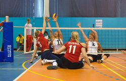 Protecting powerless. MOSCOW - MAY 11: Some players in action at 4 Open Moscow sitting volleyball match between the national team in 2014 Russia (red) and the Royalty Free Stock Photo