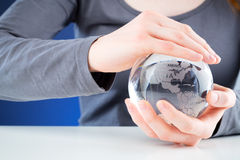 Protecting the world - hands holding a globe Royalty Free Stock Photography