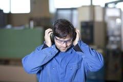 Protection auditive au travail image stock