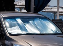 Protection of the car panel from direct sunlight. Sun Reflector windscreen.  stock image