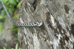 Protection chain fixed on a rock Royalty Free Stock Photo