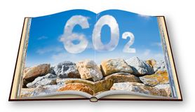 Protection from Co2 carbon dioxide emissions - concept image against a boulders wall on sky background - 3D render concept image. Of an opened photo book royalty free stock photo