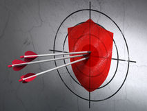 Protection concept: arrows in Shield target on wall background Royalty Free Stock Photo